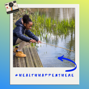 Health Happens Here, arrow pointing to young girl fishing