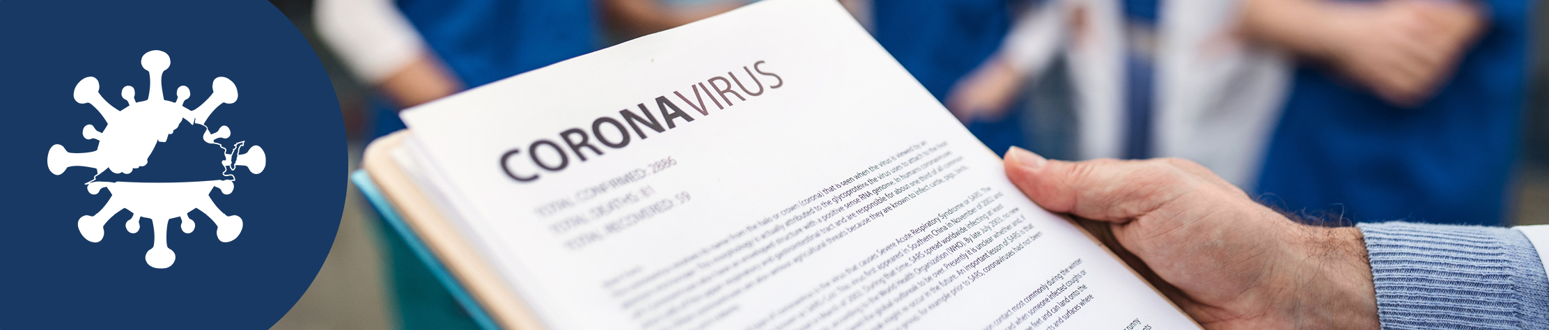 person holding Coronavirus information sheet