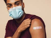 man with vaccine location bandage