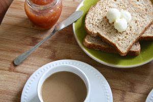 Jam, toast with butter, and coffee