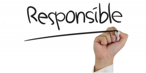 "Photo of hand writing the word ""responsible"""