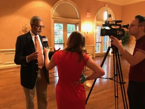Dr. Oliver is interviewed by the media