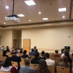 Dr. Oliver speaks to a group at VCU